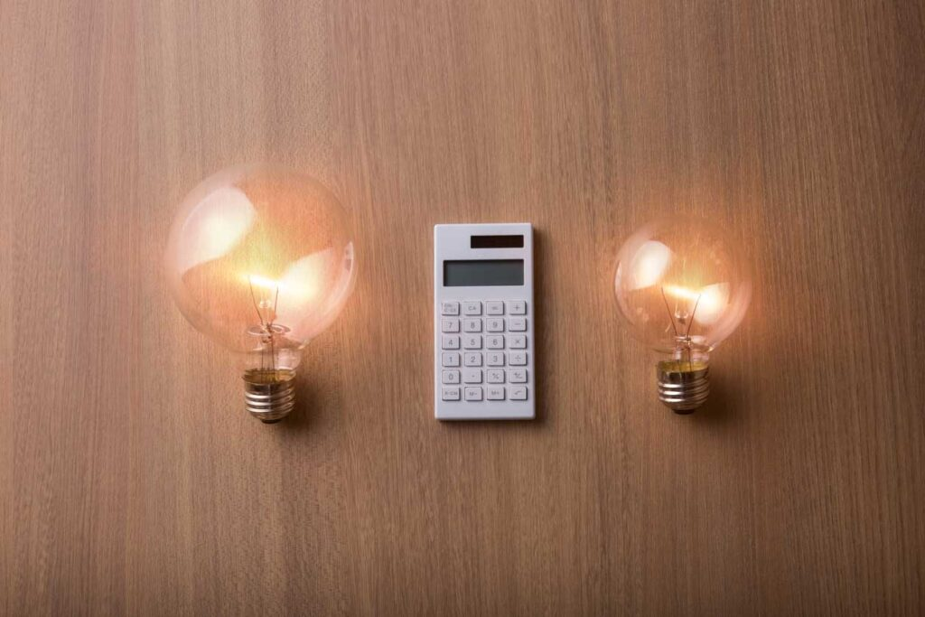 Light bulb and white calculator
