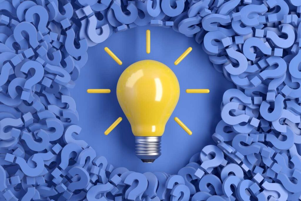 Question marks and light bulb