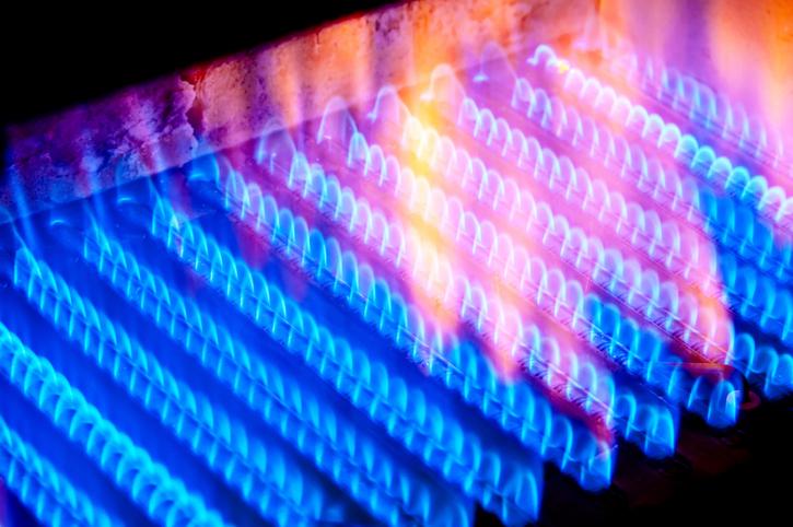 fire burns from a gas burner inside the boiler.